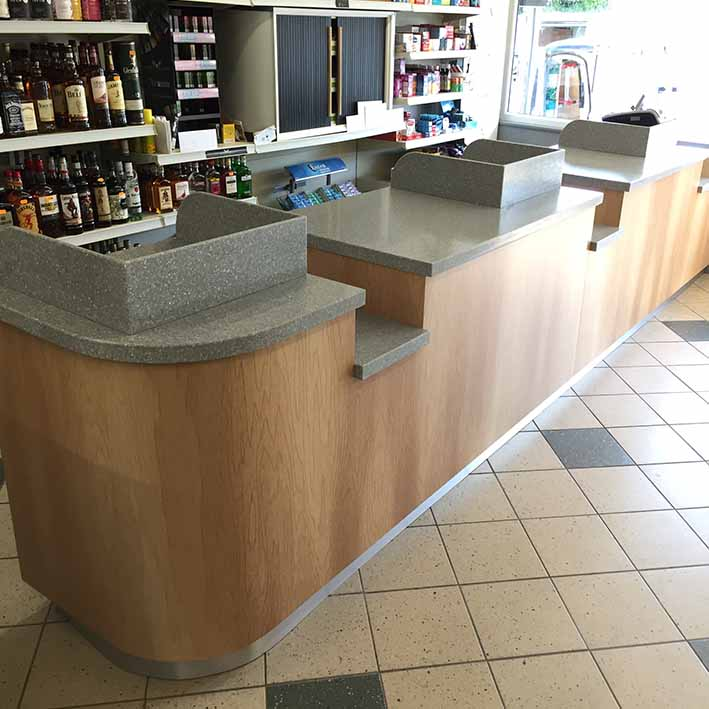 retail shop counter withbrand colours and custom curved shape